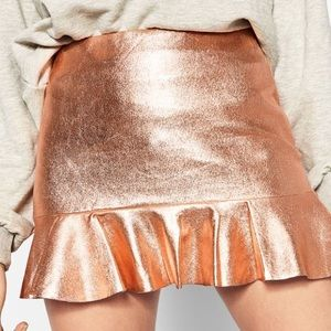 Rose gold mini skirt with ruffle